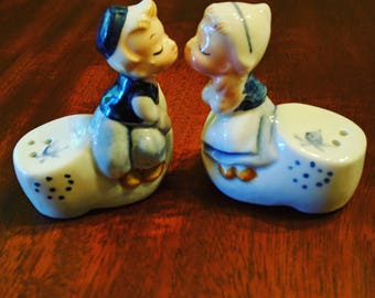 Enesco Dutch kissing boy and girl salt and pepper shakers