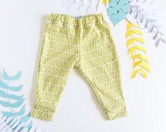 Mimosa yellow organic cotton baby leggings.
