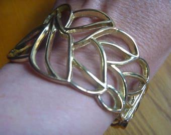 gold tone openwork hinged bracelet, vintage hinged bangle