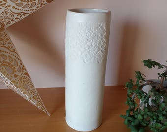 Porcelain vase with print lace