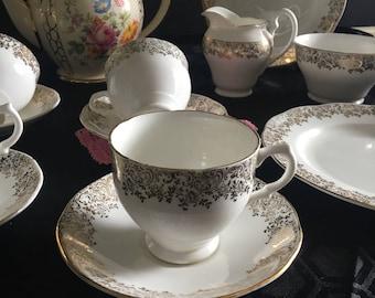 Elegant white and gold chintz royal dawn fine bone china / 12 piece jas.i.taylor ltd fine bone china tea set