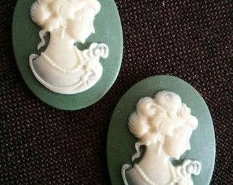 Lot 2 green oval resin cameo