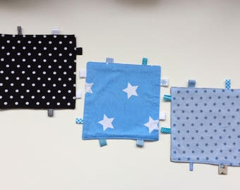 Cuddly wipes with asterisks in blue or black