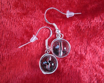 Earrings in silver with pearls