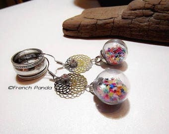 Pair of earrings glass globe and its stars