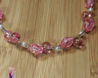 Pink necklace woven with glass beads