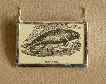 Manatee - Handmade Soldered Glass Pendant with B&W Vintage Dictionary Illustration
