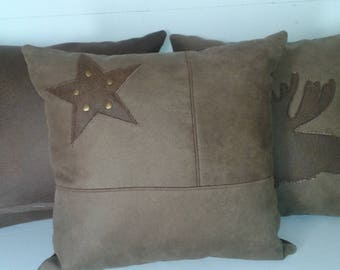 cushion caw boy or mountain faux leather and star 40 x 40
