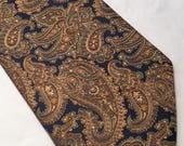 Vintage Tootal polyester black and gold 4.5 inch paisley kipper tie made in G.T.Britain