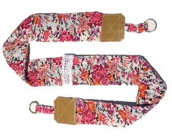 Strap from camera fabric with pink flowers and leather