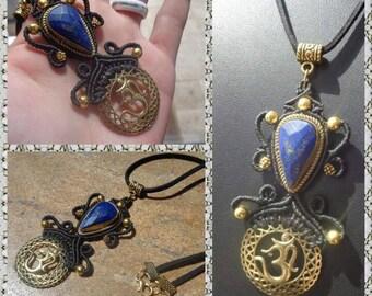 woven macrame around a lapis lazuli and ohm medal pendant