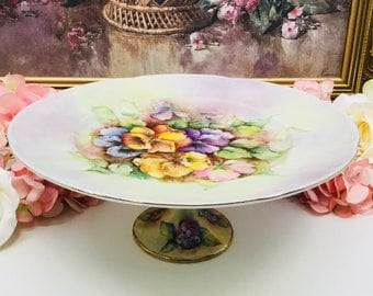 Artist signed hand painted cake stand.