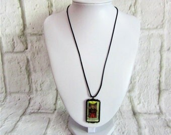 Unique black cord necklace with reversible justice tarot charm.
