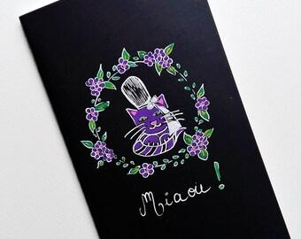 Carnet noir, purple cat