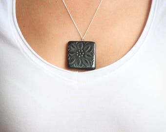 Black clay with silver necklace