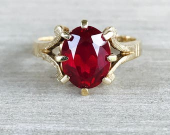 Synthetic Ruby ring in yellow gold
