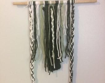 earthy green yarn wall hanging • sage, forest, white w/ braids