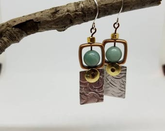Mixed Metals and adventurine combine to create a unique pair of earrings.