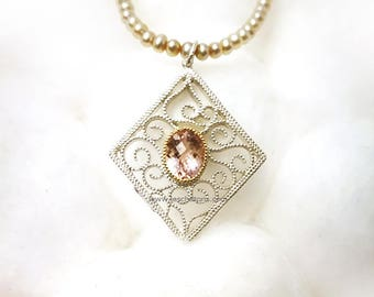 Morganite K18 and silver arabesque pendant with morganite/18 gold and silver Arabesque pendant