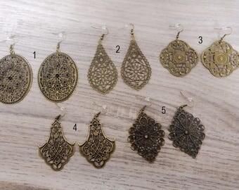 Earrings with a ornament, pendant earrings, bronze earrings