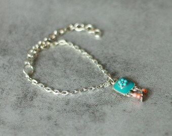 Child bracelet with turquoise, coral and Silver Flower pendant