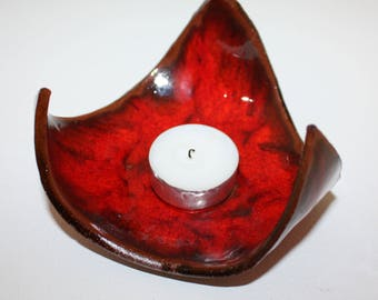Beautiful and highly decorative hand made ceramic tea light holder finished in a high gloss mottled deep red glaze.