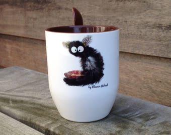 At bottom chocolate mug with funny lemur