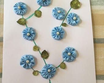 Greeting Card with a light Blue Flower Design