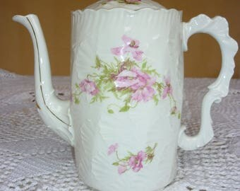 Antique romantic teapot in shabby chic style 19th century