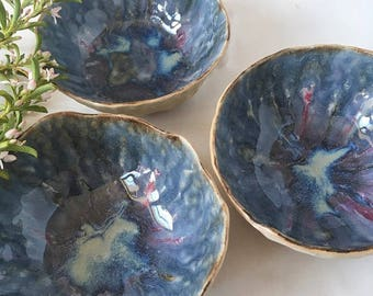 Handformed pinch pink and blue variegated stoneware ceramic bowl