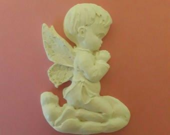 a little boy kneeling, plaster, handmade.