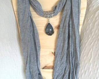 elegant grey scarf and the Center stone