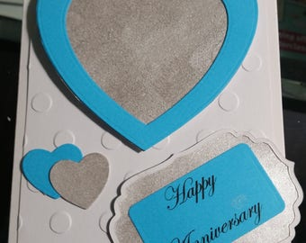 Beautiful anniversary card with blue and silver hearts