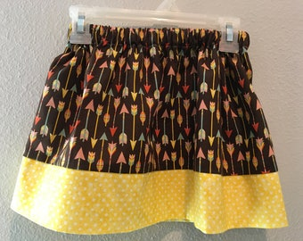 Yellow on the bottom and brown and arrow material on the top fall skirt