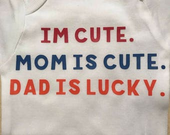 Im cute Mom is cute Dad is lucky