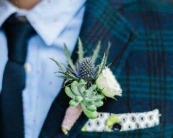 White rose boutonniere groom or groomsmen