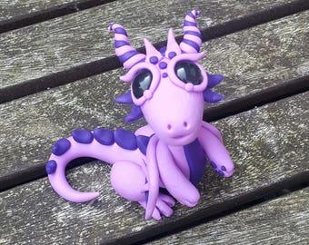 Purple polymer clay dragon miniature.