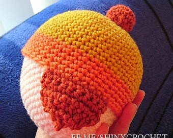 Jayne's Cunning Hat for baby - shiny crochet beanie with pom and earflaps in orange and yellow