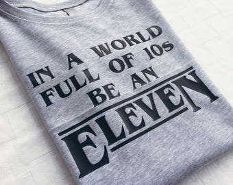 In a World Full of 10s Be an Eleven | Stranger Things Shirt | Gift for her under 25 | Funny Graphic Tee | Stranger Things Fan Shirt