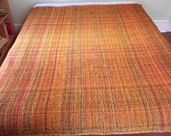 Handwoven wool blanket inspired by autumn colors