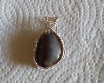 wire wrapped grey stone