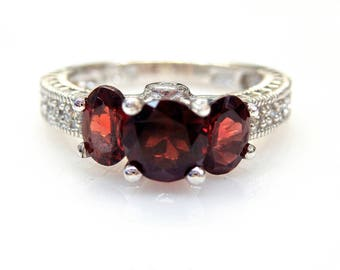 Sterling Silver Round and Oval Garnets in a row with Cubic Zirconia Accent Ring