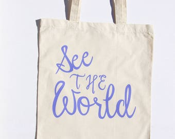 See The World Tote with violet lettering