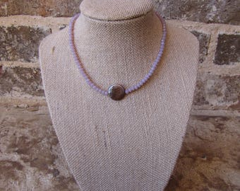 light purple choker with a purple pearl and a clasp
