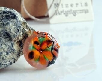 Glass orange flowery pendant