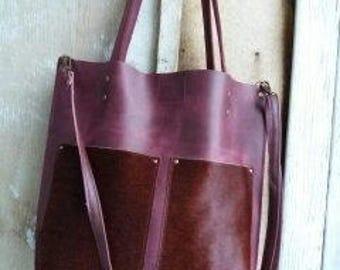 Purple leather hand bag