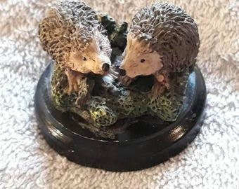 Pair Of Hedgehogs Ornaments On A Circular Black Wooden Base