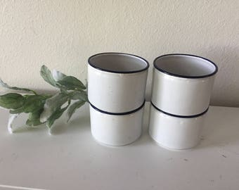 Four Blue and White Enamelware Mugs
