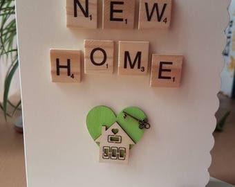 New home card, handmade, minimalistic. Heart, house and bronze key feature.
