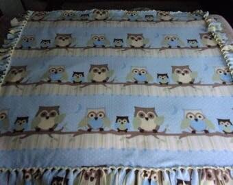 Owl family on branch fleece tie blanket